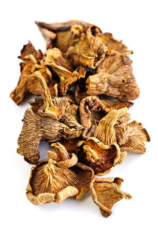 chanterelle: Dried chanterelle mushrooms isolated on white background