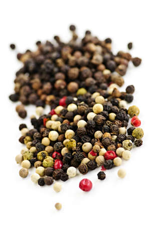 peppercorns: Mixed assorted peppercorns on white background macro Stock Photo