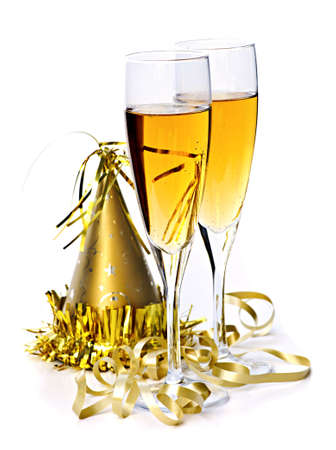 gold flute: Two full champagne flutes with party hat and ribbon isolated on white background