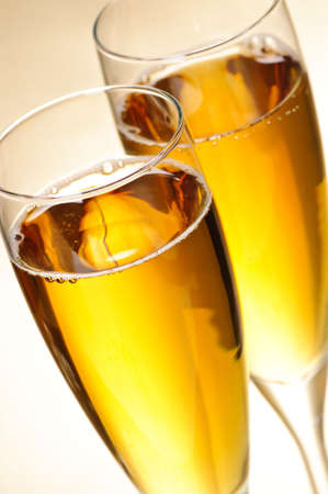 gold flute: Two full champagne flutes with sparkling wine