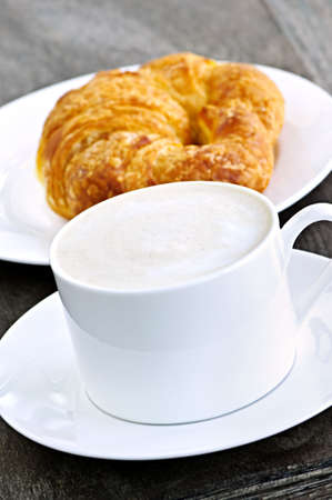 Latte coffee with frothed milk and fresh croissant Stock Photo - 5758068