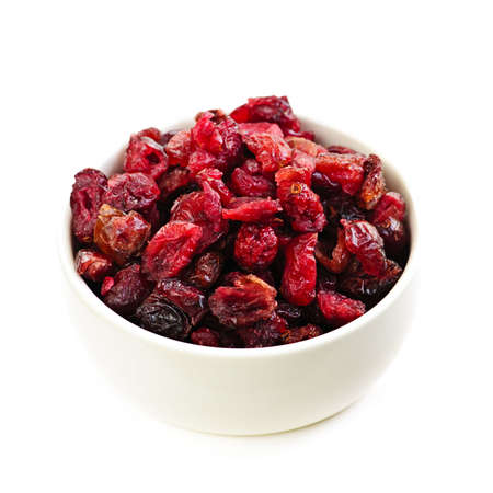 Bowl of dried cranberries isolated on white background Stock Photo - 5758063