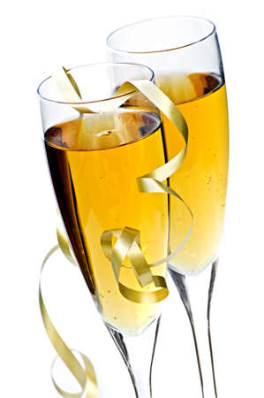 Two full champagne flutes with sparkling wine and ribbon isolated Imagens