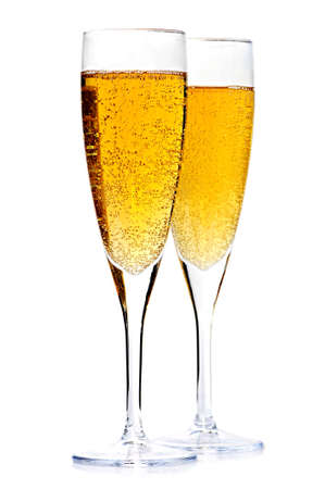 gold flute: Two full champagne flutes isolated on white background Stock Photo
