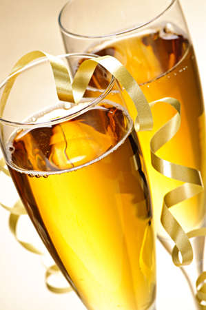 toasting wine: Two full champagne flutes with sparkling wine and ribbon