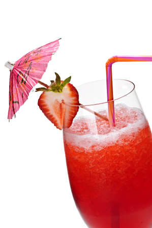 Strawberry daiquiri in glass isolated on white background with umbrella photo