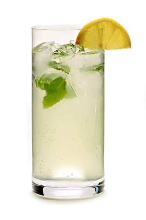 the carbonation: Glass of sparkling lemonade with mint and ice Stock Photo