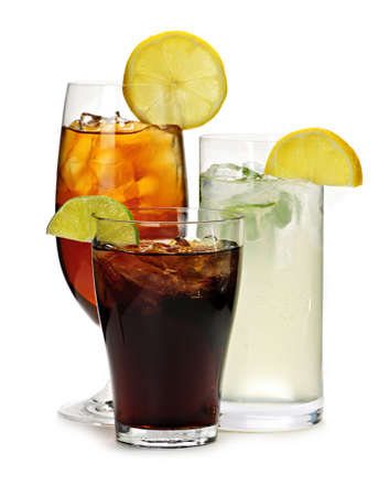 Group of three soft drinks in various glasses with garnish photo