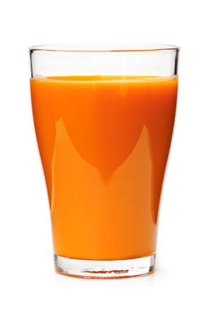 Carrot juice in clear glass isolated on white background