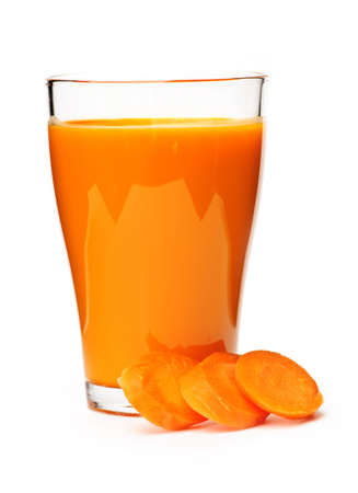 Carrot juice in clear glass isolated on white background photo