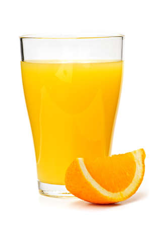 Orange juice in clear glass isolated on white background photo