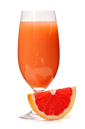 Grapefruit juice in clear glass isolated on white background photo