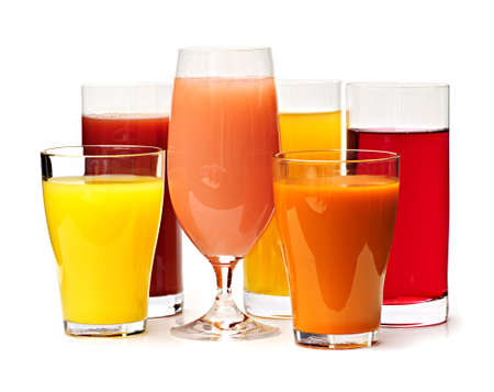 Various glasses of juices isolated on white background photo