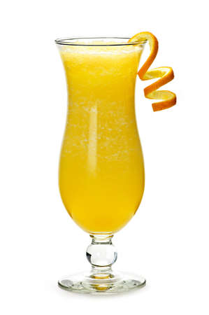 twist: Glass of orange drink in hurricane cocktail glass Stock Photo