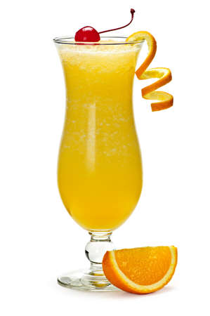 alcoholic drink: Glass of orange drink in hurricane cocktail glass Stock Photo