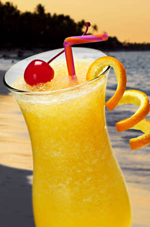 alcohol screwdriver: Glass of orange juice cocktail at tropical beach