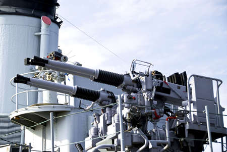 Large white guns on a military naval vessel photo