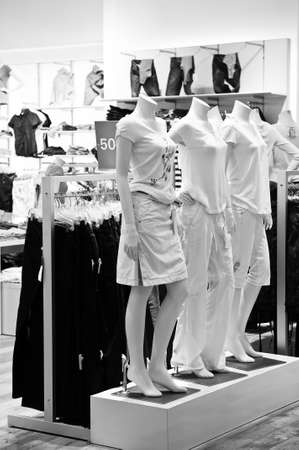 Clothing store display with mannequins in black and white photo