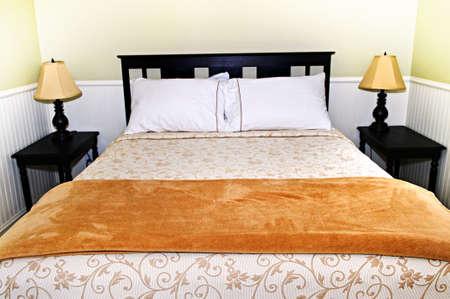 bedspread: Bedroom interior with comfortable queen size bed