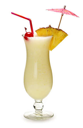 Pina colada drink in hurricane cocktail glass isolated on white background