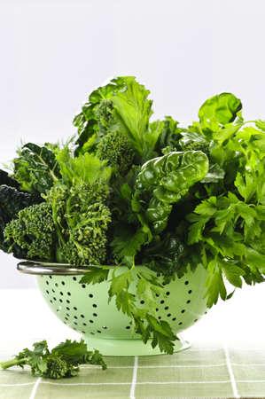 roughage: Dark green leafy fresh vegetables in metal colander