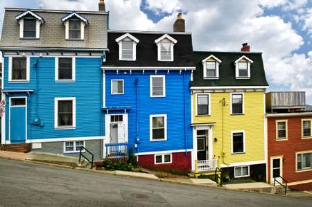 row of houses: Colorful houses on hill in St. Johns, Newfoundland, Canada