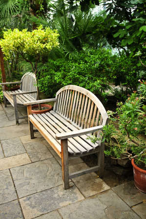 Lush green garden with stone landscaping and benches photo