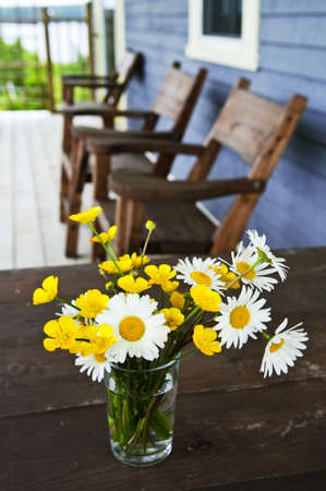 Bouquet of wildflowers on a rustic table at country cottage Stock Photo - 6031768