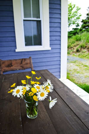 Bouquet of wildflowers on a rustic table at country cottage Stock Photo - 6031730