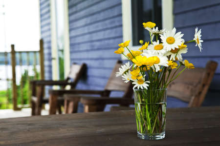 Bouquet of wildflowers on a rustic table at country cottage Stock Photo - 6031732