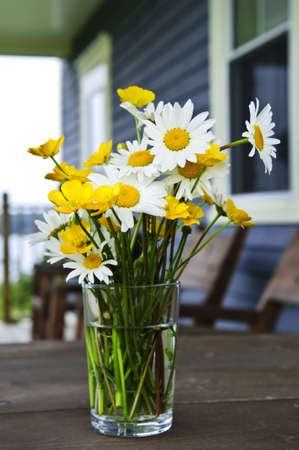Bouquet of wildflowers on a rustic table at country cottage Stock Photo - 6031728