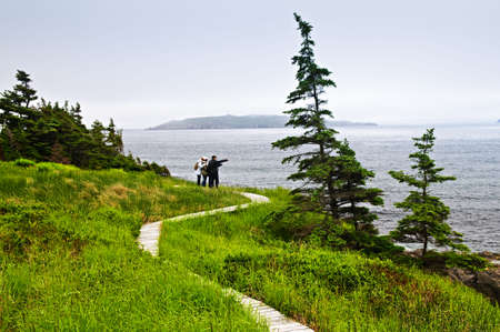 Newfoundland: Father and children standing at Atlantic shore in Newfoundland, Canada Stock Photo