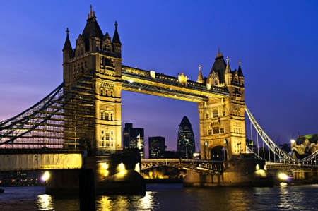 Tower bridge in London England at night over Thames river photo