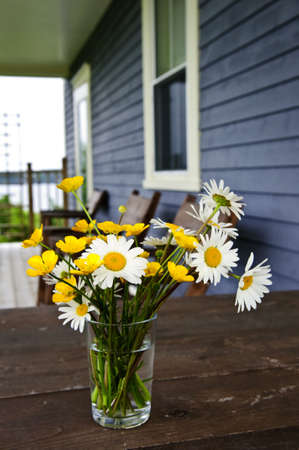 Bouquet of wildflowers on a rustic table at country cottage Stock Photo - 25381845