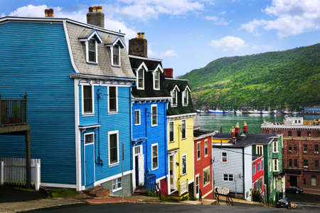 row of houses: Street with colorful houses near ocean in St. Johns, Newfoundland, Canada