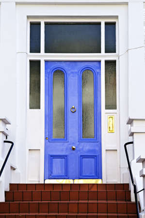 Blue front door with brass knocker in London England photo