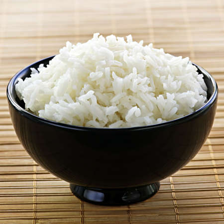 basmati: White steamed rice in black round bowl