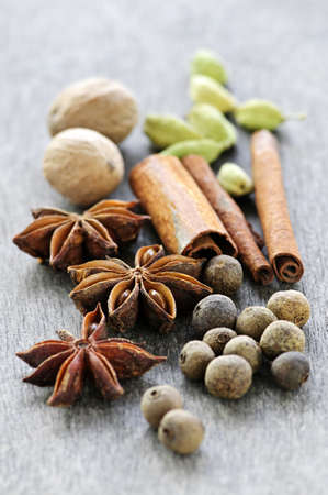 Assorted whole spices close up on wooden background Stock Photo - 6121203