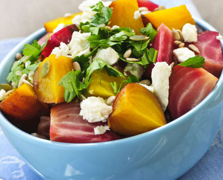 Closeup on bowl of roasted sliced red and golden beets Stock Photo - 6166842