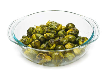 Casserole dish of roasted cooked green brussels sprouts photo
