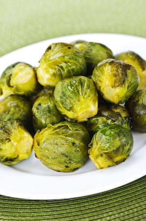 Plate of roasted green brussels sprouts on placemat