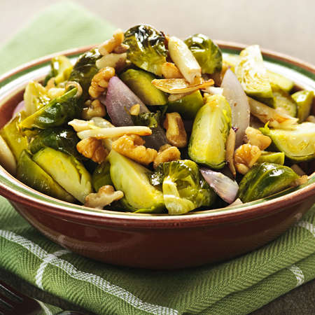 brussels sprouts: Vegetarian bowl of roasted brussels sprouts with walnuts