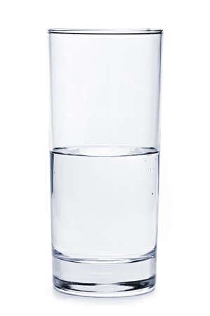 Glass of water half empty isolated on white background photo