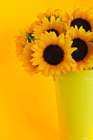 Bouquet of sunflowers in yellow metal vase photo