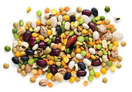 Mixture of dry beans and peas isolated on white background photo