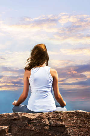 Portrait of young teenage girl practicing yoga at sunset Stock Photo - 6219910