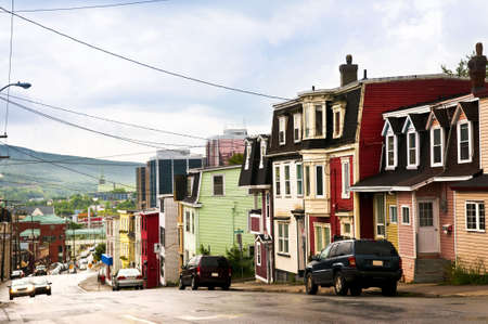 nfld: Street with colorful houses in St. Johns, Newfoundland, Canada Stock Photo