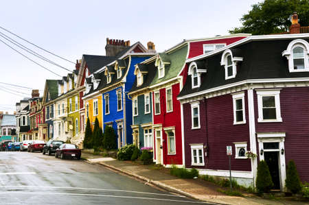 yellow house: Street with colorful houses in St. Johns, Newfoundland, Canada Stock Photo