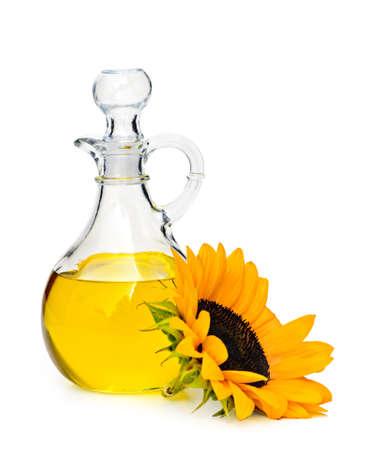 De fles en de bloem van de zonnebloemolie op wit wordt geïsoleerd dat Stockfoto