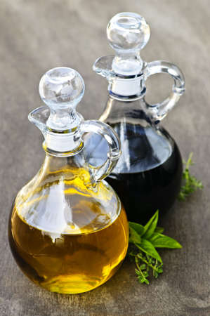 balsamic: Oil and balsamic vinegar glass bottles with spouts Stock Photo